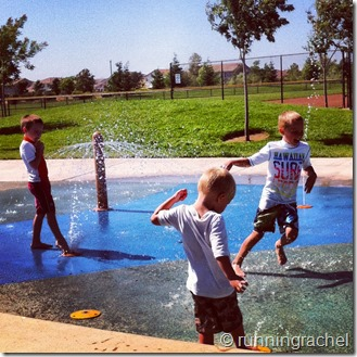 boys play splash pad